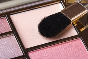 makeup palette in pink tones with an applicator. blush