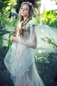 Beautiful blond woman with the flower wreath