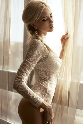 sexy glamour woman in lace lingerie looking at window