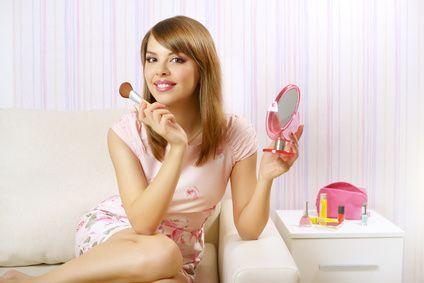 Portrait of girl with make-up brush